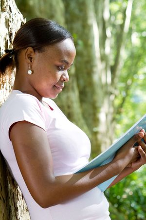 african student reading in park Stock Photo - 6652064