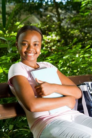 african student reading in park Stock Photo - 6652057