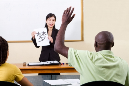 university word: asian woman teaching african students