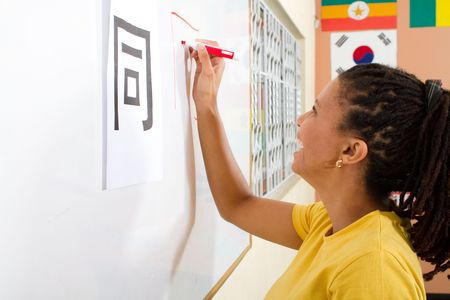 adult african student studying chinese characters photo