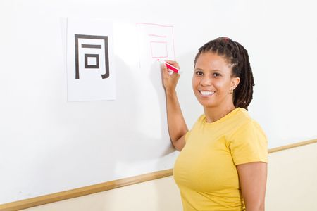 female african student learning chinese writing Stock Photo - 6638953