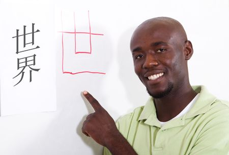 try: male african student learning chinese writing