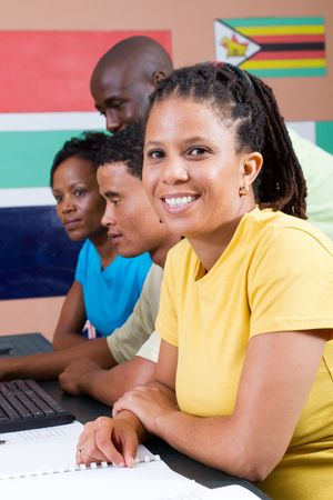 african student: pretty female african student with classmates Stock Photo