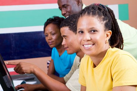 african education: happy african american adult students in classroom