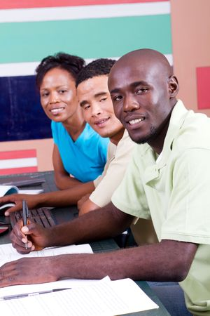 ged: happy african american computer classmates Stock Photo