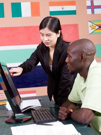 teacher tutoring adult african computer student Stock Photo - 6639034