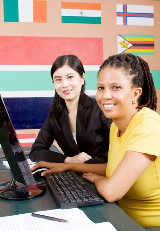 teaching adult: tutor teaching adult african student computers Stock Photo
