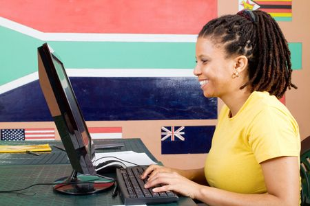 ged: african adult student using computer