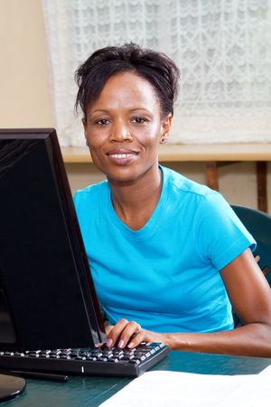 african student learning computer photo