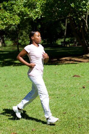 destress: african woman jogging