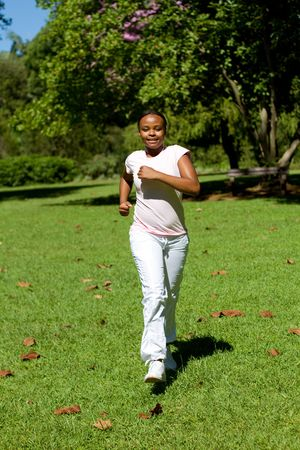 african woman running in park photo