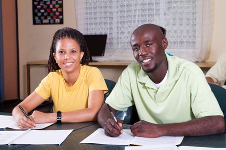 studious: two adult educations students in classroom