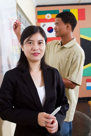 chinese adult education teacher with student photo