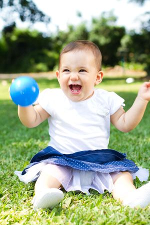 laughing baby girl outdoors photo