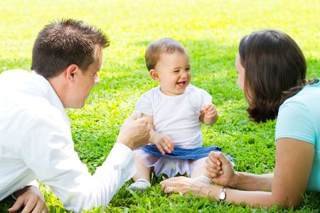 happy family playing outdoors Stock Photo - 6704530