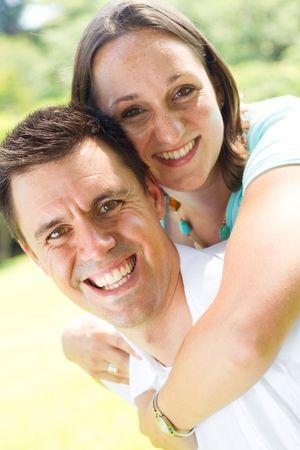 young couple piggyback Stock Photo - 6687606