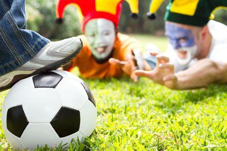 fanatical: football hooligans fighting for ball