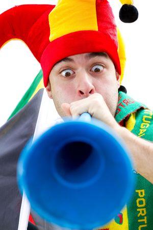 sports fan blowing vuvuzela photo