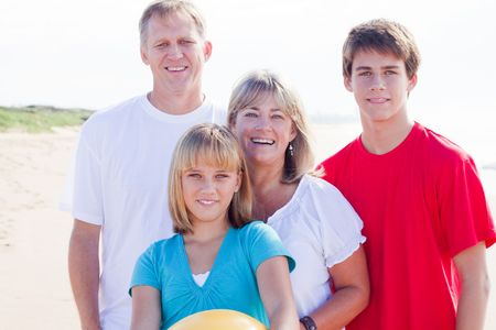 attractive family of four on beach Stock Photo - 6784041