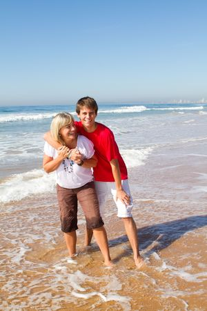 mother and son on beach photo