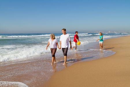 familiy playing on beach photo