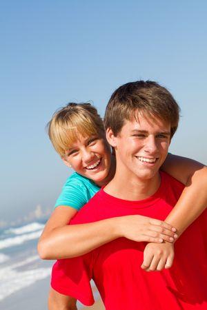 spunky: brother and sister piggyback