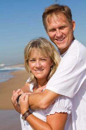 anniversary beach: happy mature couple on beach