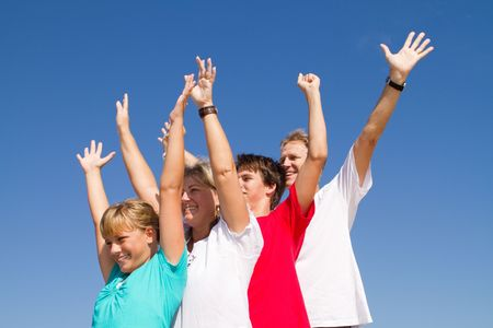 family with outstretched arms outdoors photo