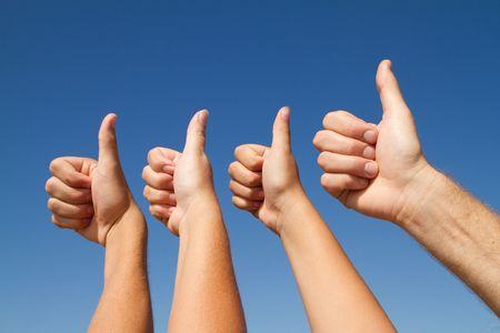 metaphor: family thumbs up Stock Photo