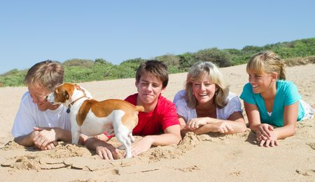 active holiday: happy family on beach Stock Photo