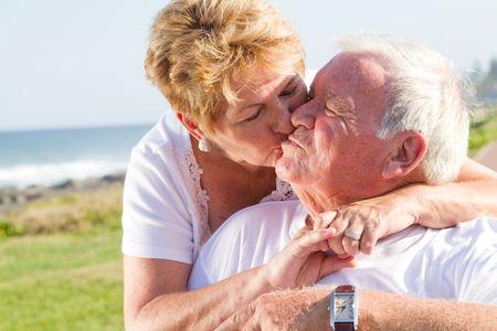 senior couple kiss photo