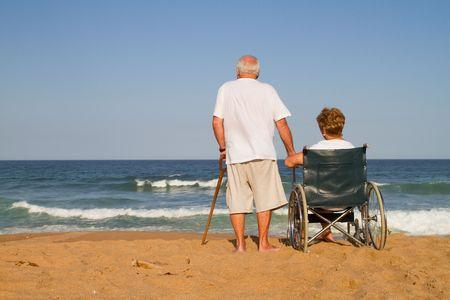 elderly couple on beach photo