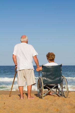 husband and wife on beach  photo