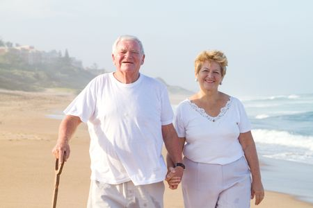 portrait of happy senior couple on beach photo