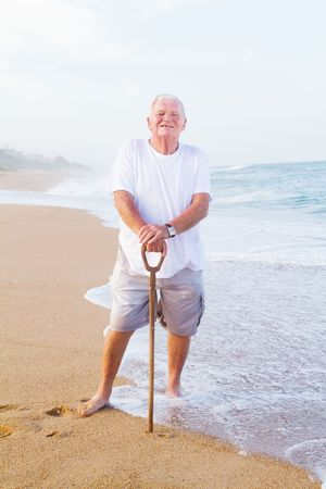happy senior man on beach photo