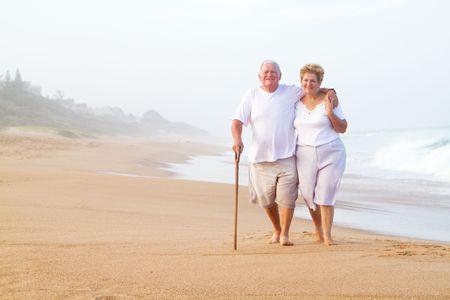 senior couple walking on beach Stock Photo - 6855362