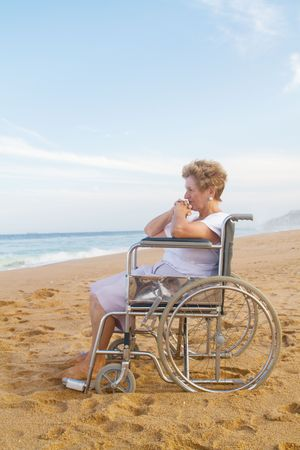woman in wheelchair on beach photo