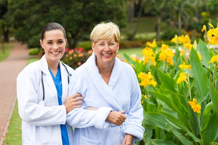 young nurse helping senior patient photo