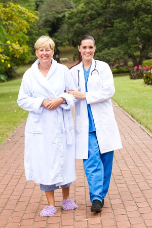 recovering: doctor and recovering patient Stock Photo
