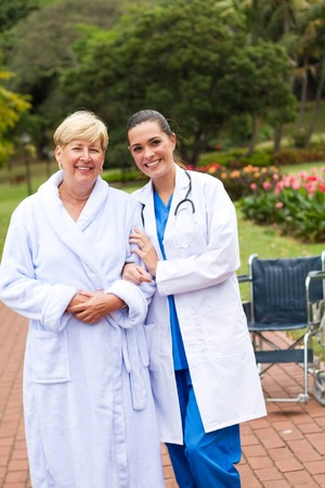 hospital gown: young nurse and senior patient