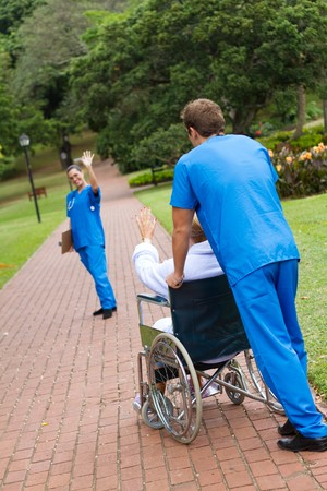 nurse waving goodbye to patient Stock Photo - 7013591