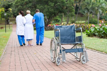 physical therapists helping patient walk Stock Photo - 7013600