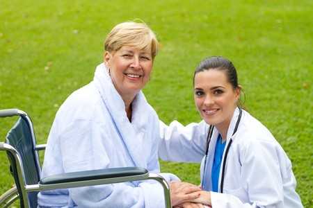 private nurse and happy patient in park photo