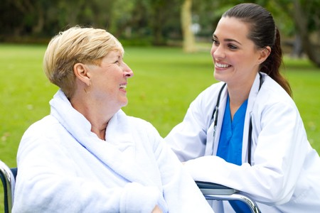 friendly female doctor with patient photo