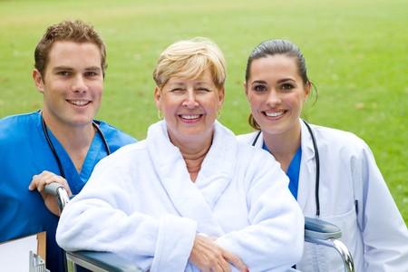 senior patient with friendly doctors photo