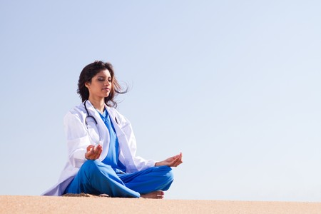 yoga meditation: nurse practicising yoga meditiation