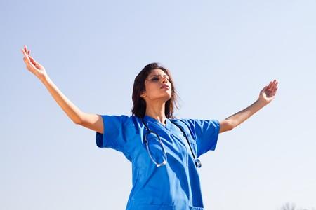 young spiritual nurse on beach photo