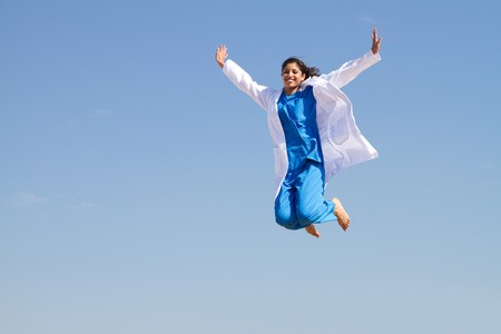 young resident jumping high in sky photo