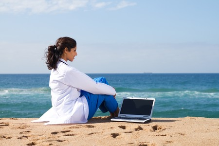 doctor relaxing on beach  photo