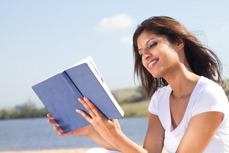 beautiful arabic woman reading book photo